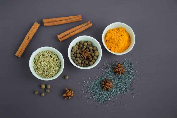 assorted spices near white ceramic bowls